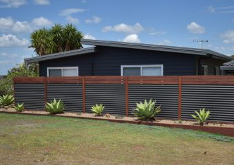 Winner Innovation and Excellence in COLORBOND® steel Fencing - Custom Orb with Australian Hardwood project by Northern Rivers Fencing
